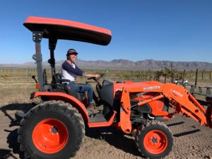 Jamie driving the tractor
